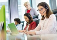 Call center manager observes agents