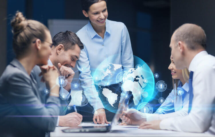 a team of colleagues working around a table with a globe on it