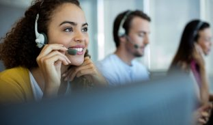 smiling woman in call center